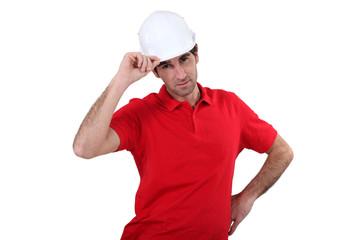 craftsman putting on his helmet