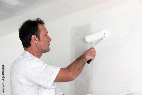 Man repainting room white