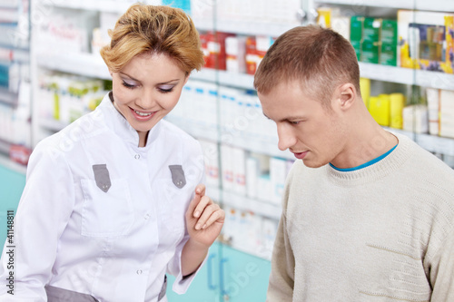 The pharmacist and the customer at the pharmacy