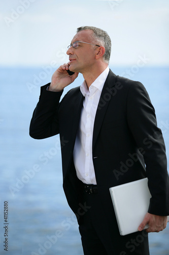 executive on the phone profile-view