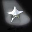 Silver star at dark stage in spotlight 3d