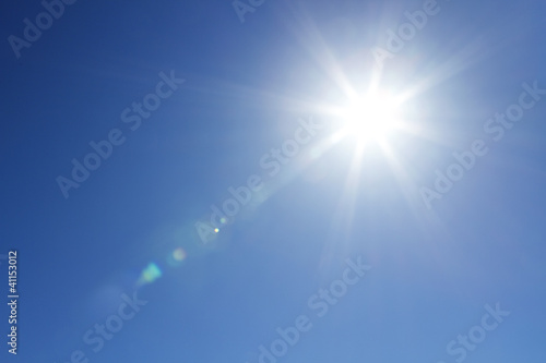 Shining sun at clear blue sky with copy space - 41153012