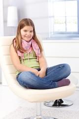 Happy schoolgirl at home