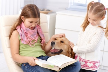Little sisters with dog at home