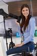 Portrait of beautiful photographer in studio