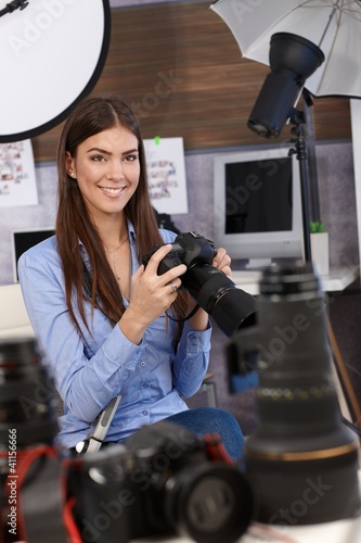 Beautiful photographer with camera