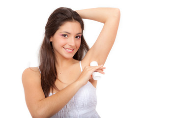 young woman putting on deodrant