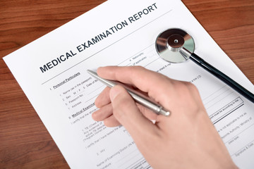 Doctor fills out a medical examination form