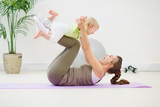 Fototapety Healthy mother and baby making gymnastics