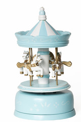 Blue merry-go-round toy on white