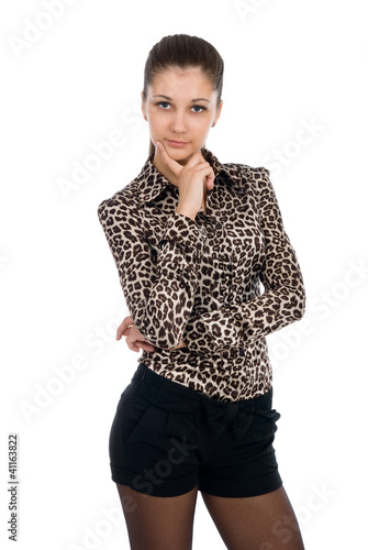 Portrait  young woman posing in shorts and animal print blouse