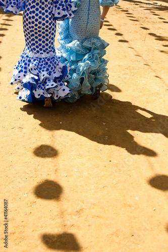 Women wearing flamenco dresses at Seville's fairground.