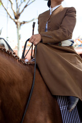 Horse woman wearing the traditional spanish traje corto