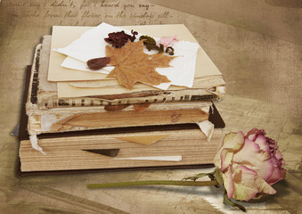 Stack of vintage books and rose