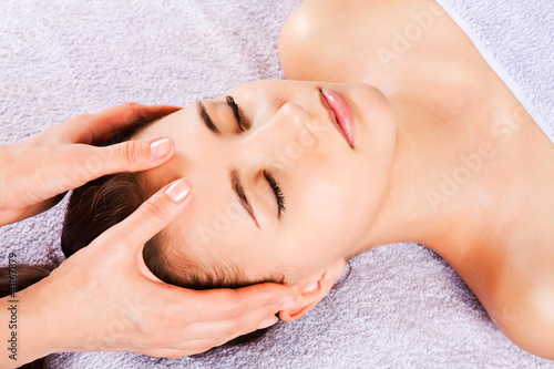 Beautiful girl receiving facial massage