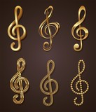 Vector set of golden decorative treble clef