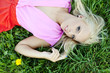 Beautiful sexy young woman outdoors, lying in the grass, relaxin