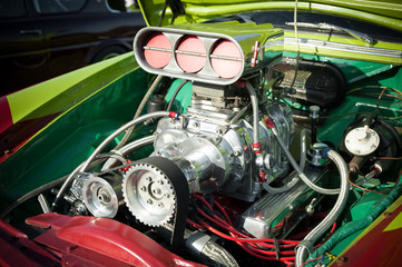 powerful supercharge blower inside a hot-rod engine bay