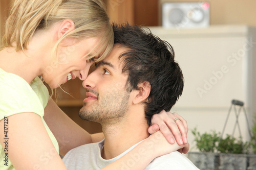 Young woman staring at her boyfriend tenderly