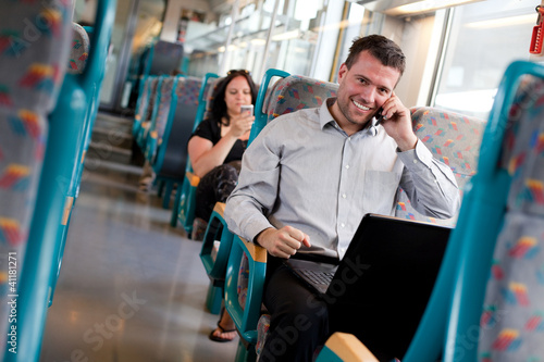 Handsome businessman working on the train