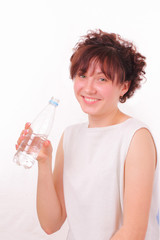 Funny young girl with a bottle of mineral water
