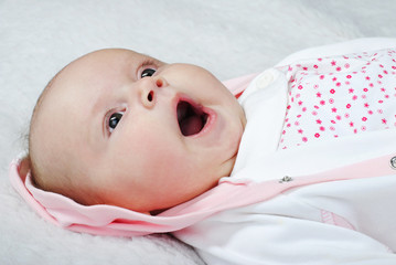 small breast child yawns