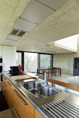 house in cement, interior, wooden kitchen island