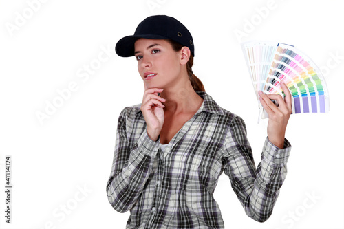 A woman holding a color model.