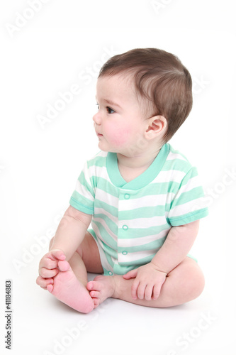 Cute baby playing with his toes