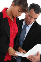 Businessman and businesswoman  using laptop