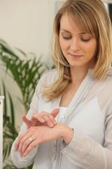 Woman trying hand cream