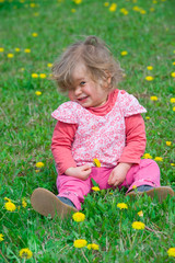 funny girl in the spring meadow
