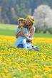 mother and son in dandelion field