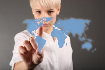 World business concept - business woman touching screen