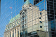 Downtown Ottawa reflected in office building