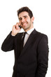 Portrait of a smiling business man with phone,  isolated on whit