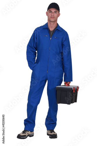 Man arriving at work with tool box