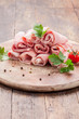Raw Ham rolls on wooden table