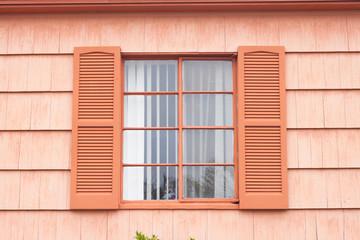 Vintage window with orange tone wall