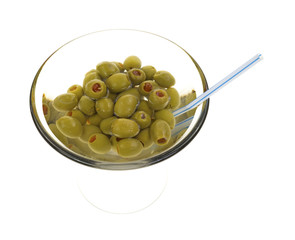 Olives in martini glass with straw