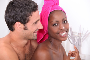 couple preparing in bathroom