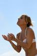 Woman splashing around in the sea