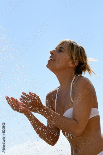 Woman splashing around in the sea