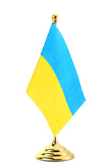Flag of Ukraine hanging on the golden flagpole