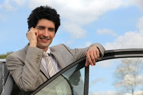 Man using mobile in his car