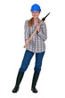 Woman holding axe over shoulder