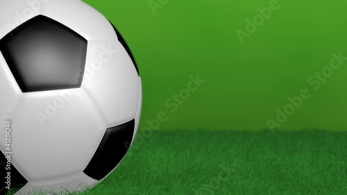 Rotating soccer ball on green background