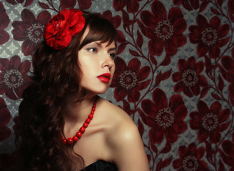 young beautiful girl with red flower in hair