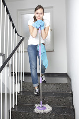 Woman cleaning the hall