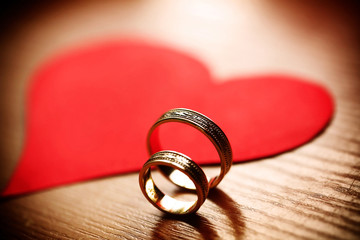 Beautiful wedding golden rings with a heart